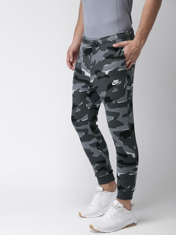 Nike Men Grey & Black Camouflage Print NSW CLUB CAMO Joggers Nike Track Pants at myntra