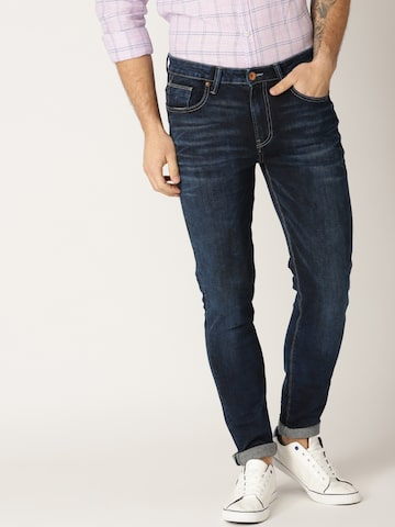 United Colors of Benetton Men Navy Blue Tapered Fit Mid-Rise Clean Look Stretchable Jeans United Colors of Benetton Jeans at myntra