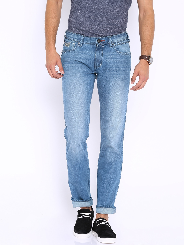 77791557 Buy Wrangler Men Blue Low Rise Rockville Tapered Fit Stretchable ...