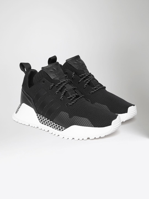 46a4a19978318 Buy Nike Men Black Air Huarache Run Ultra Mid Top Sneakers - Casual ...