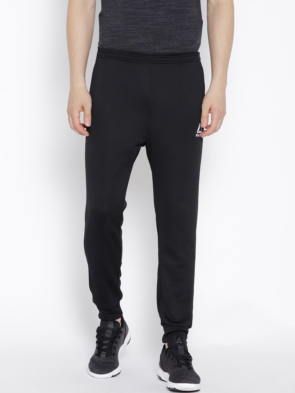 38a0134fc641e Buy Reebok Men Grey Speedwick Knit TRACKSTER Training Track Pants ...