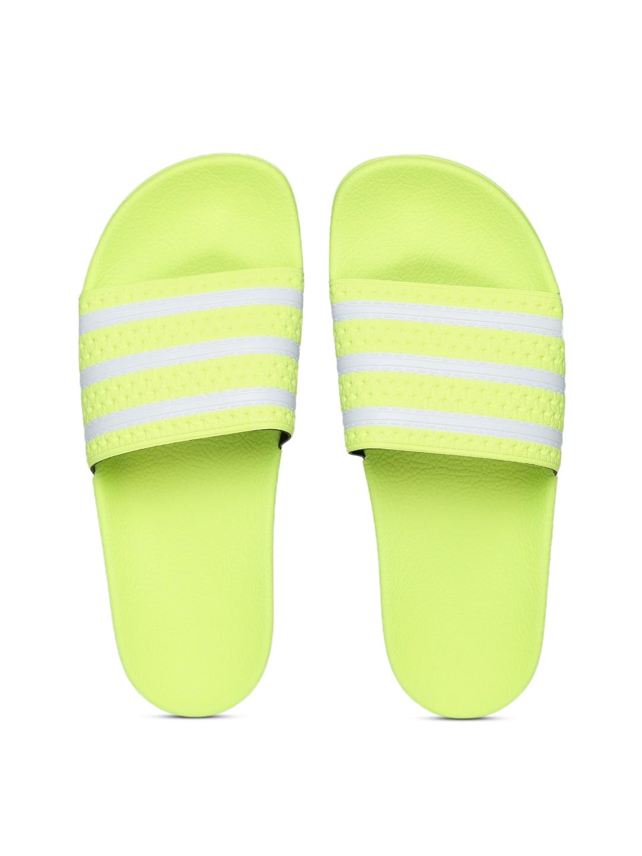 1a2d19633bec9 ADIDAS Originals Men Fluorescent Green   Off-White Adilette Striped Sliders