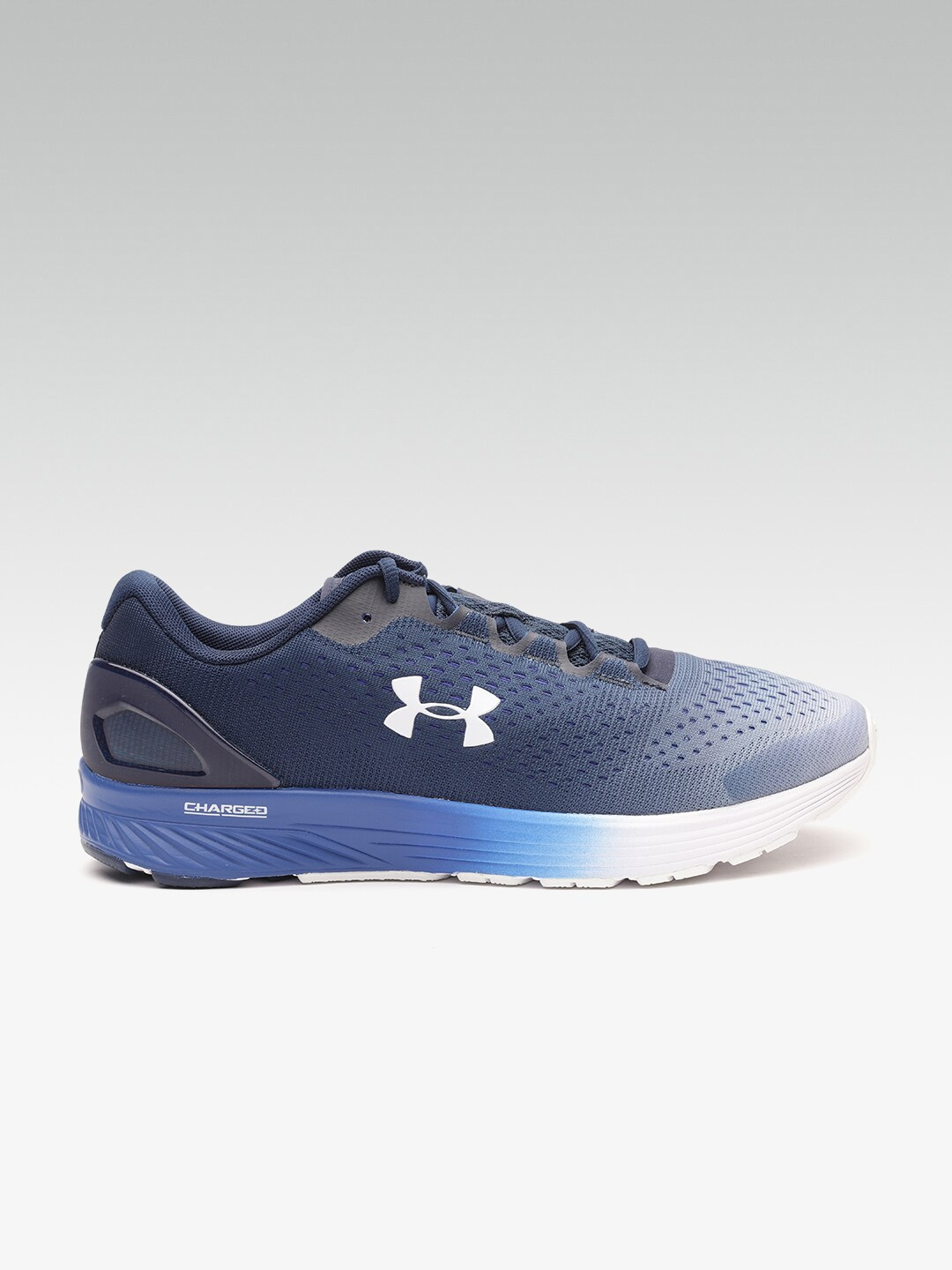 outlet store 064ca 0e66f Buy UNDER ARMOUR Men Navy Blue Charged Bandit 4 Running ...