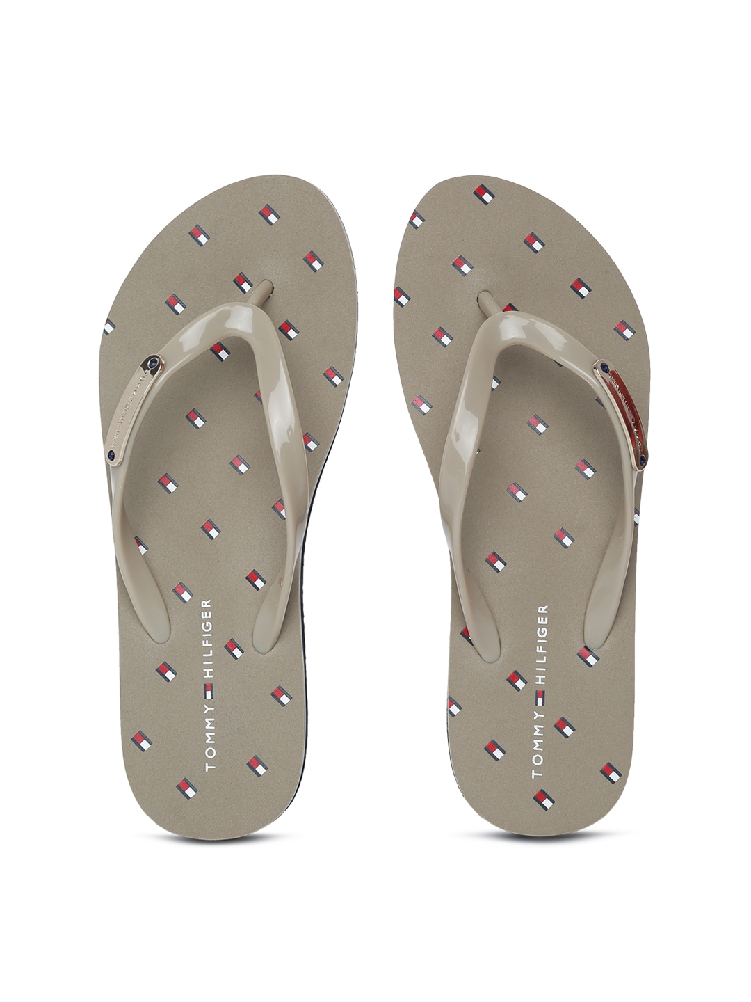 c12cd5f0715e Tommy Hilfiger Beige Flip Flops for women - Get stylish shoes for ...