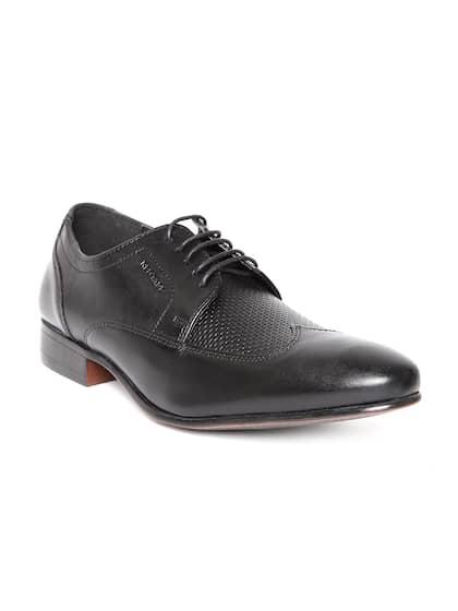 1e3523a3 6b2639d3-04d9-4576-8228-1460dac2ce7f1528434850770-Red-Tape-Men-Black-Leather-Formal-Shoes-9031528434850228-1.jpg