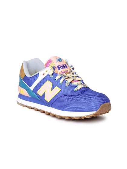 best website c694c 3a231 New Balance. Women WL574EXA Solid Sneakers