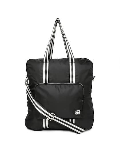 e69adda698c Size. Steve Madden Black Solid Handheld Bag