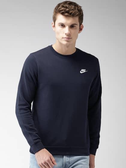 4c4a9c496487 Nike. Men Solid Sweatshirt