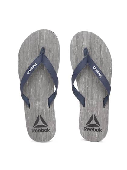 03e7bd744f1a5d Reebok Women Navy Blue   Grey Printed Thong Flip-Flops