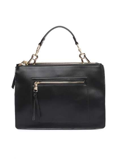 Steve Madden Black Solid Handheld Bag