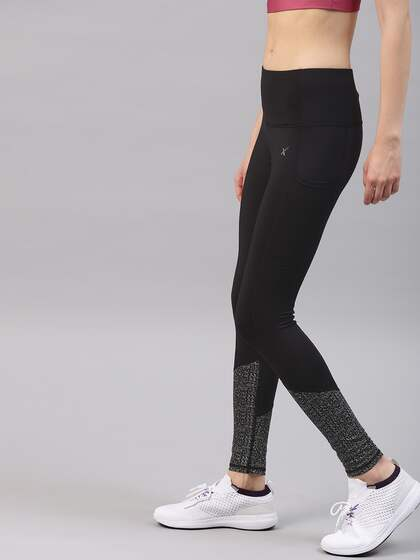 4ede28925ae HRX by Hrithik Roshan. Women Solid Running Tights