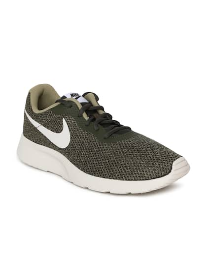 new styles c6752 c3ad1 Nike. Men Tanjun SE Sneakers