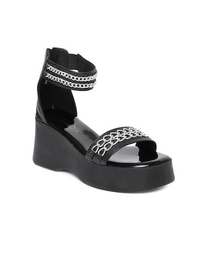 7bb088332f4 Catwalk Women Black   Silver-Toned Solid High-Top Flatforms