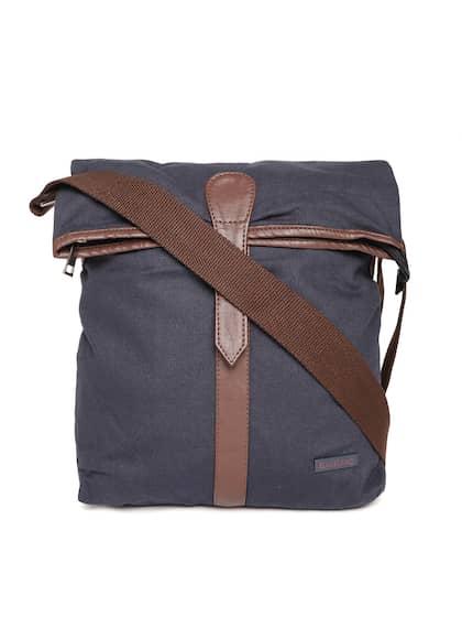 8c3a3b8a439d BAD HABIT. Solid Messenger Bag