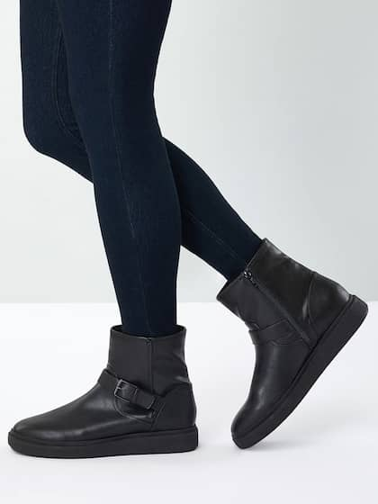 bcadb6655ff next Women Black Solid Synthetic Mid-Top Flat Boots