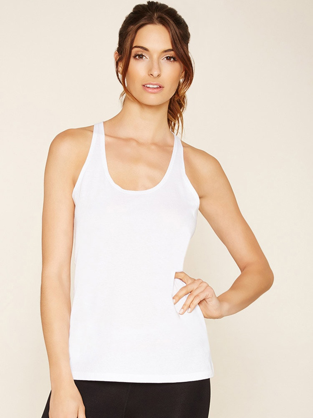 a09da7234fa67 Buy FOREVER 21 Women White Tank Top - Tops for Women 1450871 | Myntra
