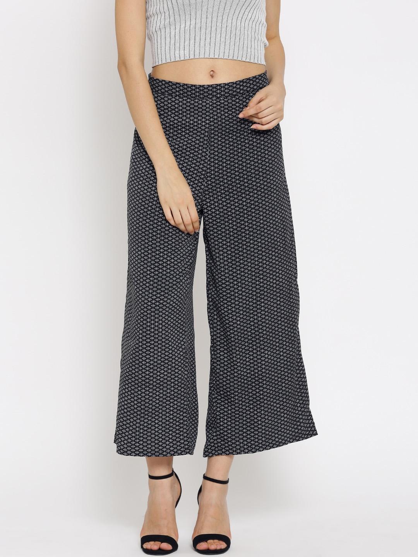 a8b30637144c1 Buy Sera Women Black & White Printed Ankle Length Palazzo Trousers ...
