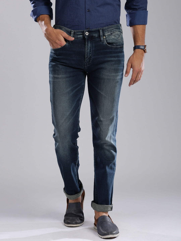 f7155f4c0 Buy Tommy Hilfiger Men Blue Regular Fit Mid Rise Clean Look Jeans ...