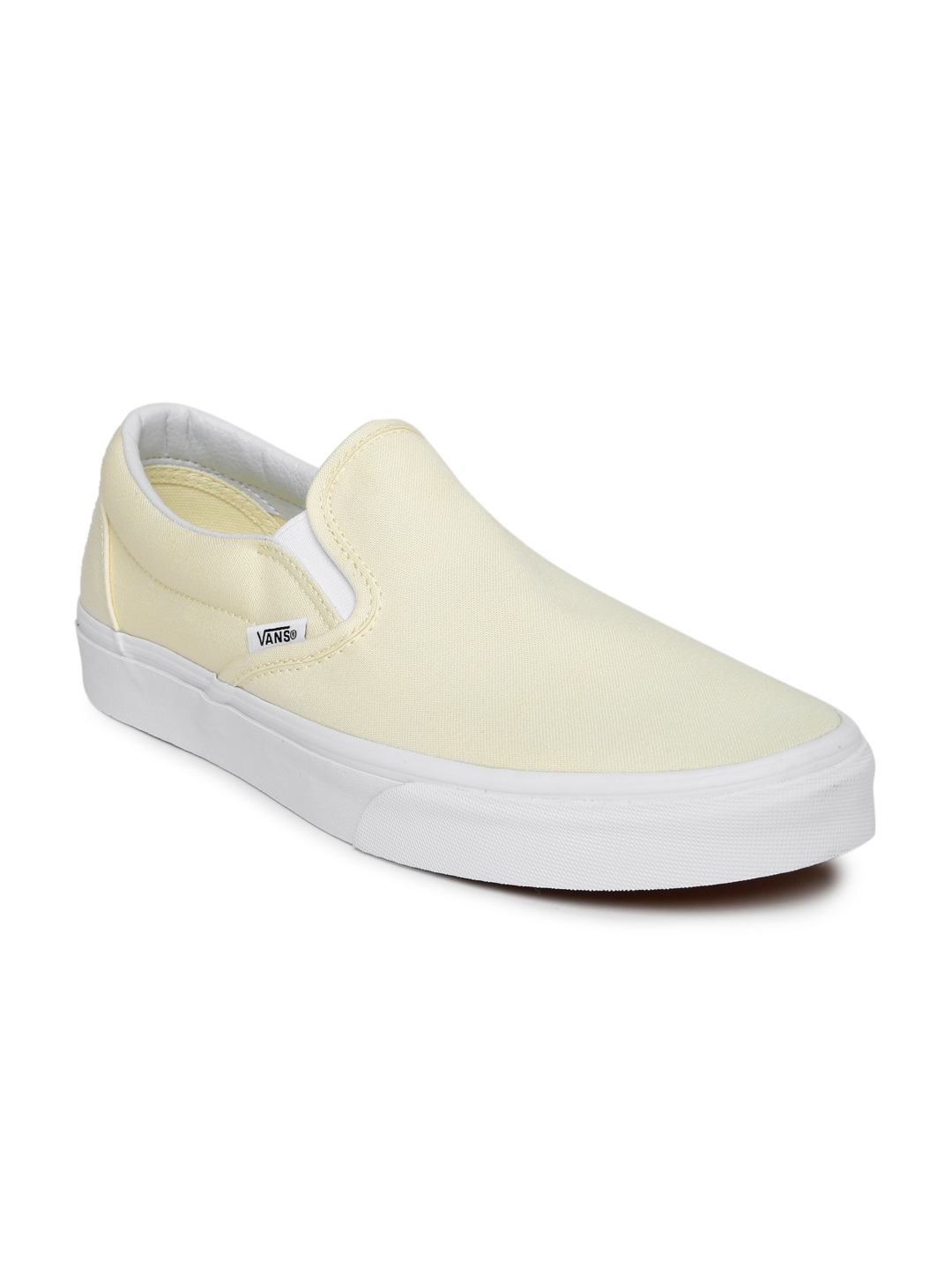 772400876b567f Buy Vans Unisex Cream Coloured Solid Classic Slip On Sneakers ...