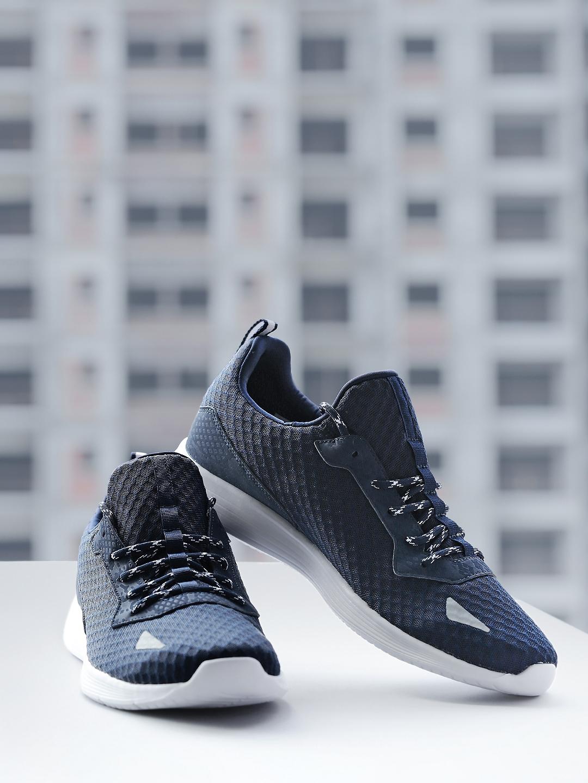 Buy Reebok Men Navy Blue Solid Regular