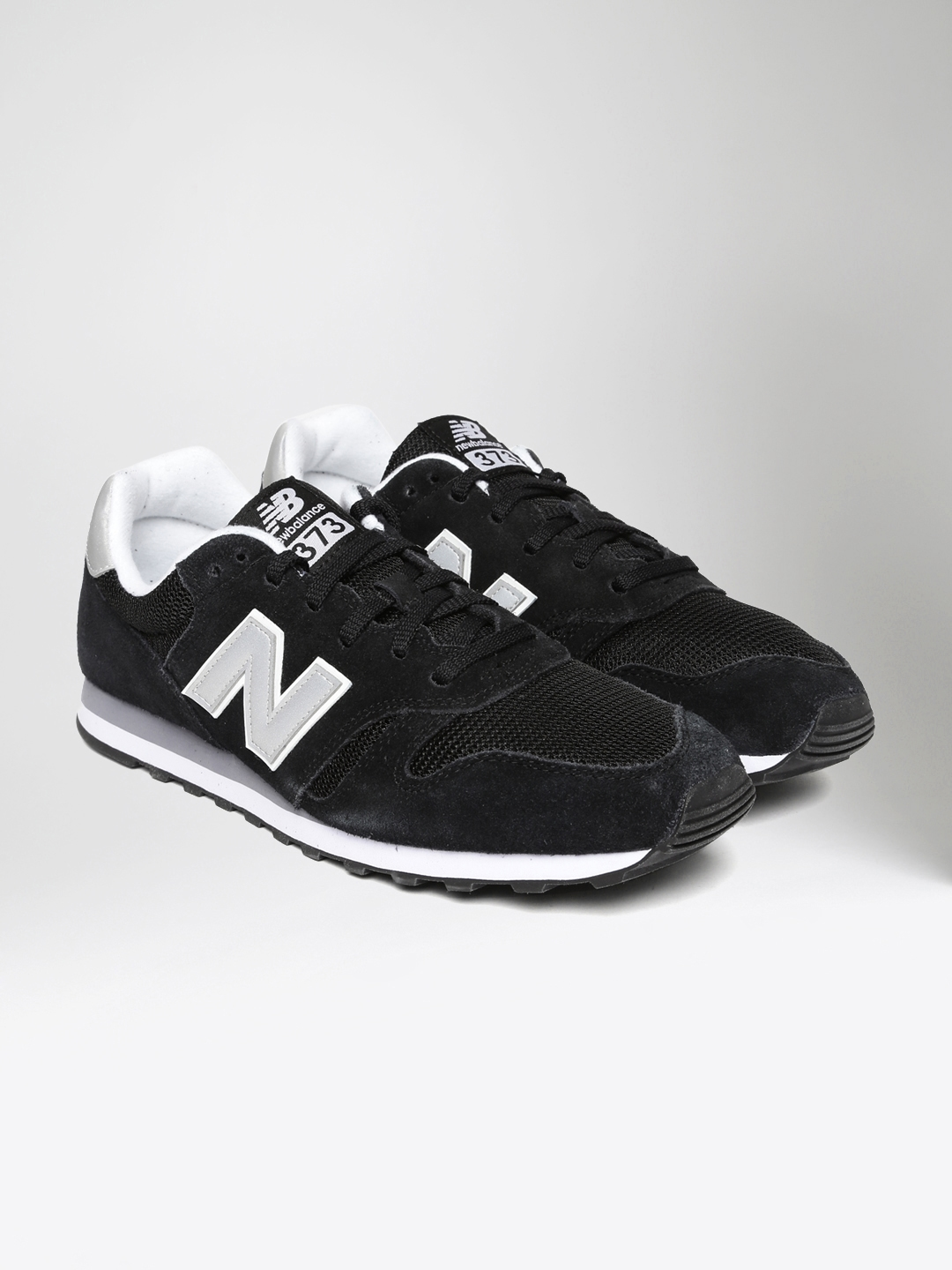 64e9beebfa428 Buy New Balance Men Black 373 Sneakers - Casual Shoes for Men ...