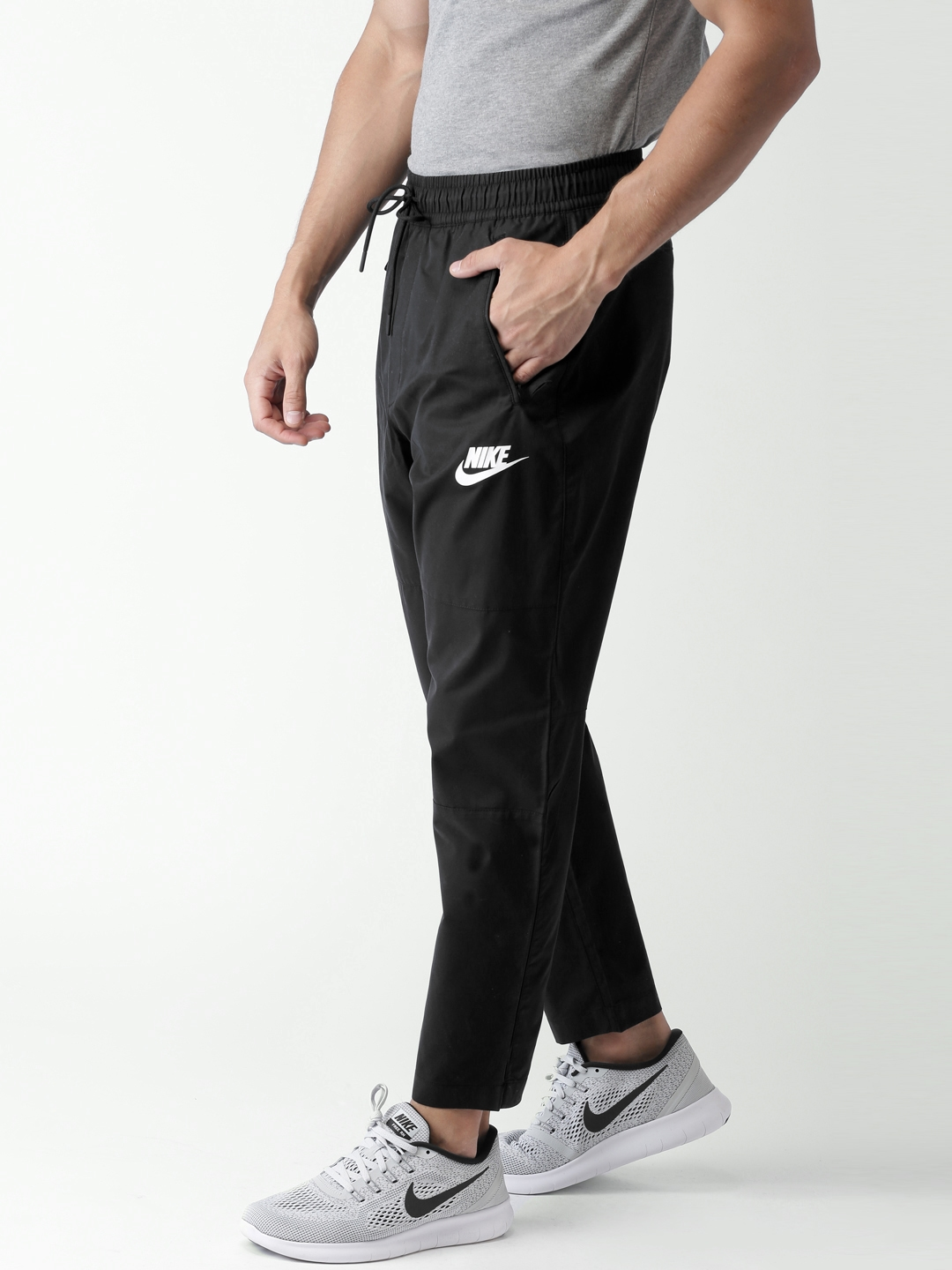 e3621341 Buy Nike Men Black Slim Fit AS M NSW AV15 PANT WVN Track Pants ...