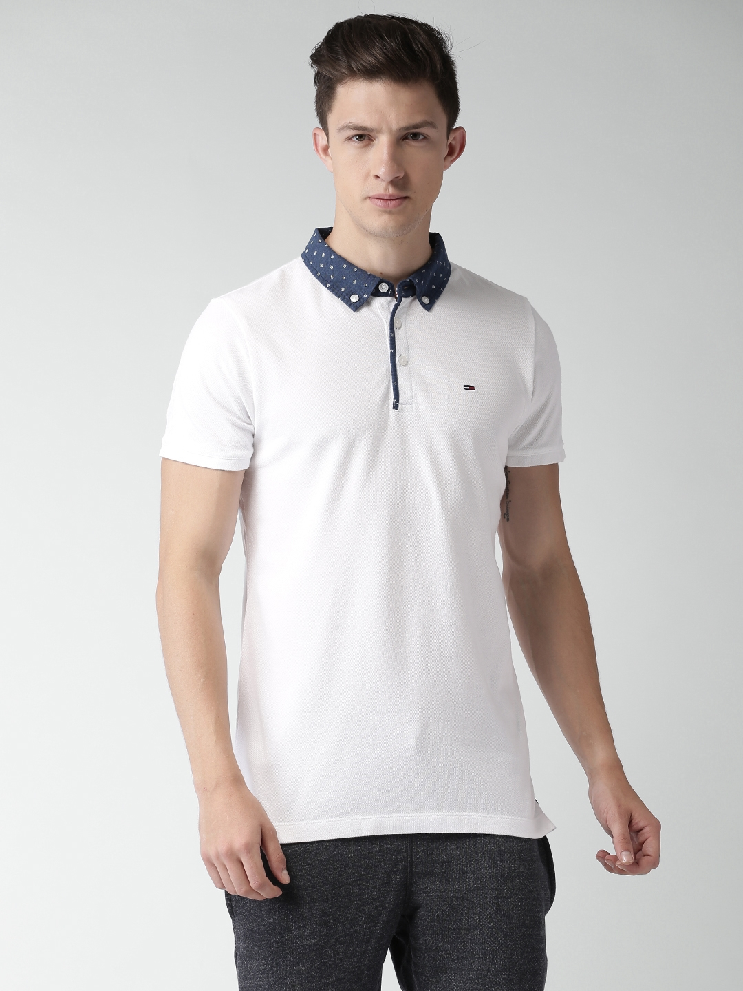 Buy Tommy Hilfiger Men White Solid Polo T Shirt - Tshirts for Men ... d463cfd30e2