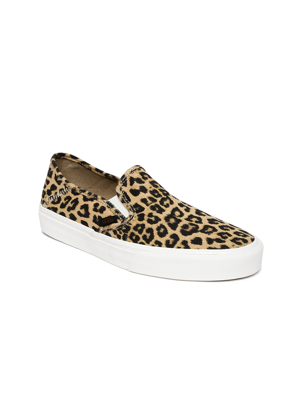 b73f7e5991 Buy Vans Women Beige   Black Animal Print Slip On Sneakers - Casual ...