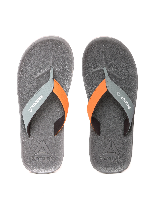 3ab95c6c38dea7 Buy Reebok Men Grey Adventure Colourblocked Flip Flip Flops - Flip ...