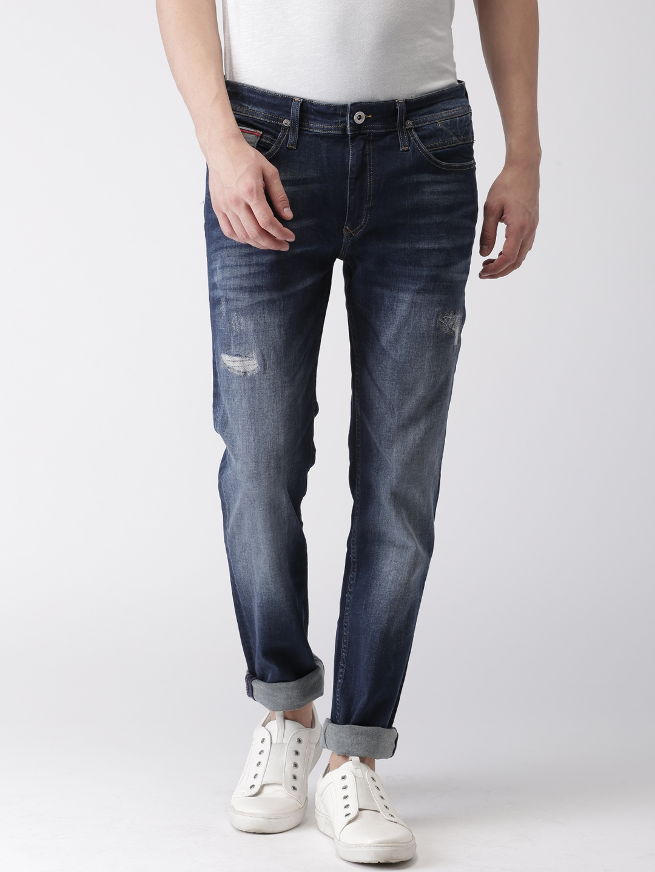 42765fb4907e Tommy Hilfiger Men Blue Slim Fit Mid-Rise Mildly Distressed Stretchable  Jeans