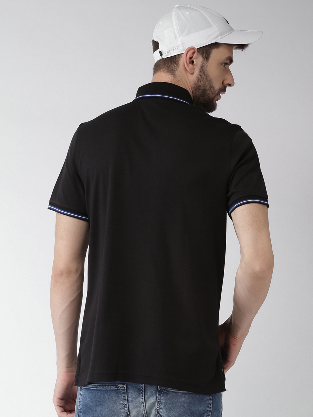 Buy Tommy Hilfiger Men Black Solid Loose Fit Polo Collar T Shirt