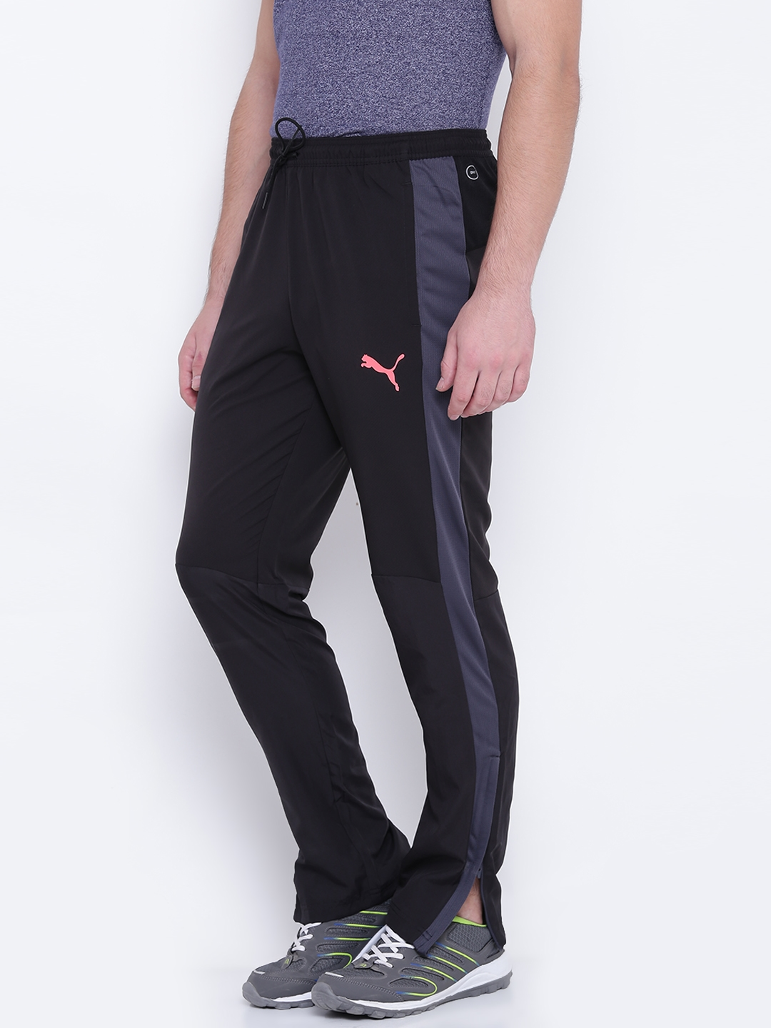98615dec7827 Buy Puma Men Black EvoTRG Woven Track Pants - Track Pants for Men ...