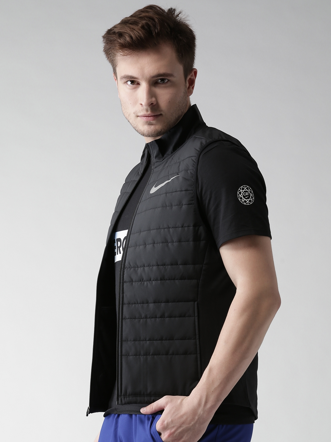 a20dc9d4228b8 Buy Nike Men Black AS FIlled Essential Solid Sleeveless Insulator ...