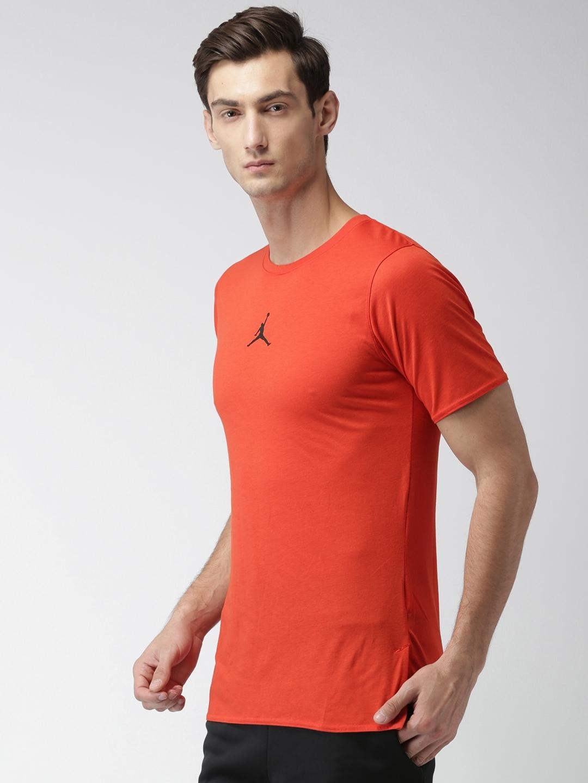 f7076ed41729fc Buy Nike Men Rust Orange Solid Round Neck NBA JORDAN 23 Alpha ...