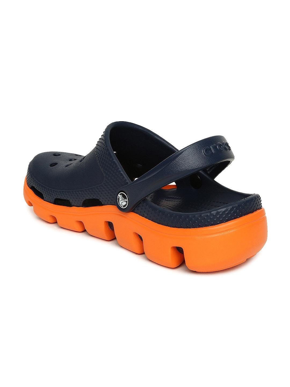 c7c998e97629 Buy Crocs Unisex Navy Duet Sport Clogs - Flip Flops for Unisex ...