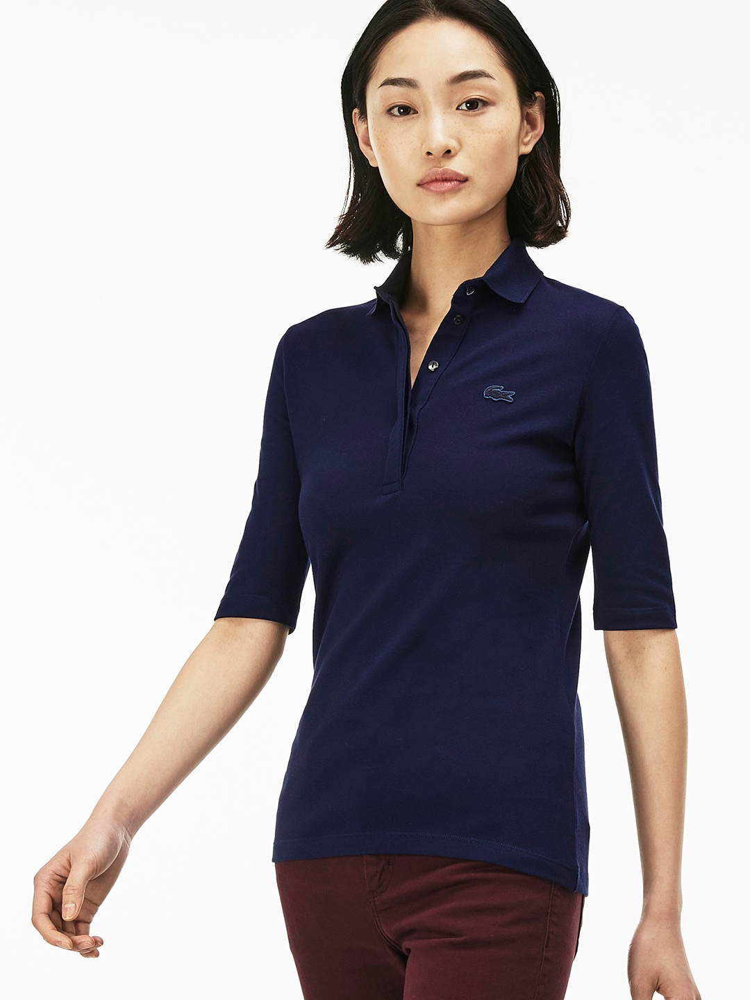 b93fa412eae Lacoste Women Navy Blue Solid Polo Collar T-shirt. This product is already  at its best price