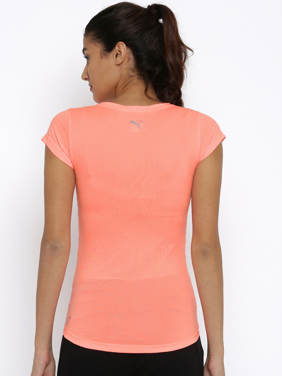 93d62585d2be6 Buy Puma Women Peach Coloured Heather Cat Solid Slim Fit V Neck T ...