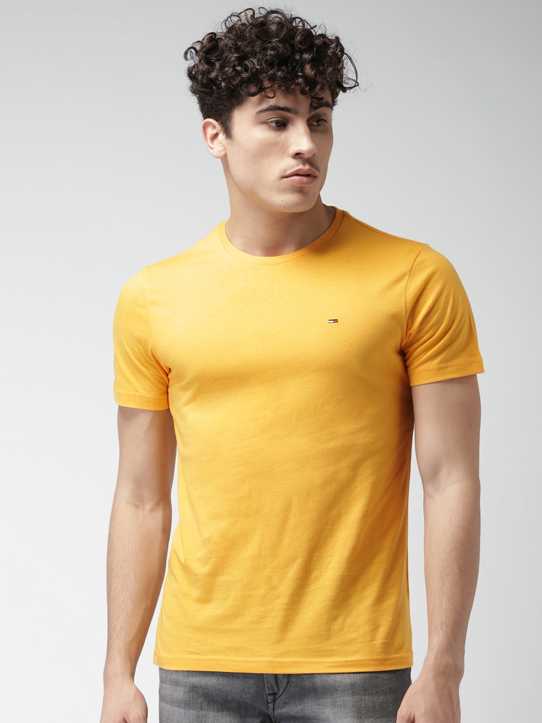 2f4bcd3cc96e2 Buy Tommy Hilfiger Men Yellow Solid Round Neck T Shirt - Tshirts for ...
