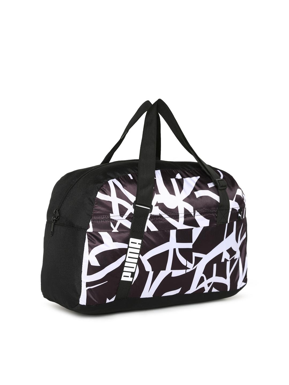 eb88bed1386a Buy Puma Women Purple   Black Core Active Printed Sports Duffel Bag ...