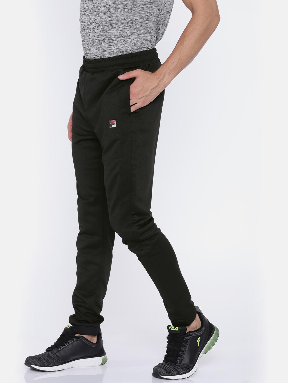 58eaf0d9 Buy FILA Men Black RENZO Joggers - Track Pants for Men 2458377   Myntra