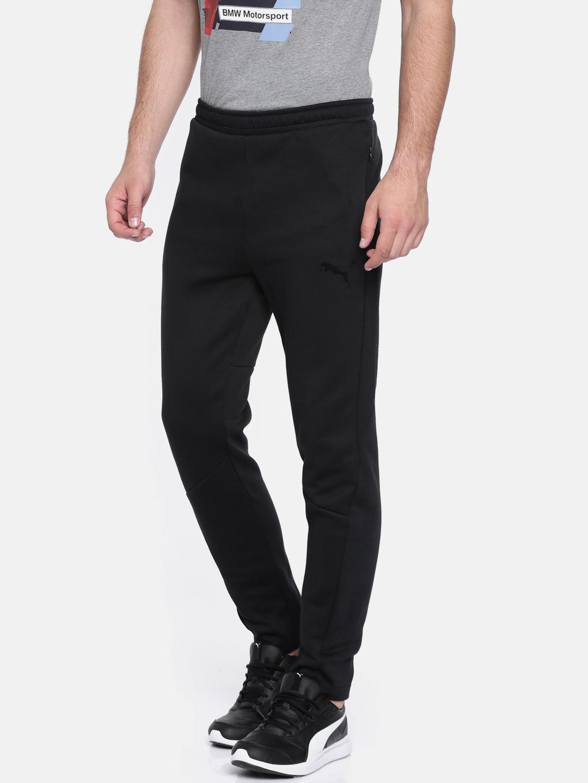 ea56de028 Buy Puma Black Evostripe Move Track Pants - Track Pants for Men ...