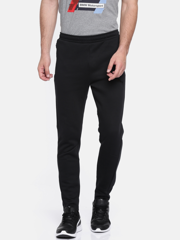45f87f404a7a Buy Puma Black Evostripe Move Track Pants - Track Pants for Men ...