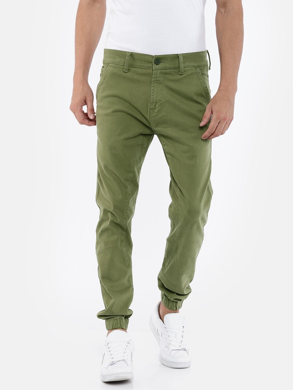 aab8f449713 Buy Wrangler Men Olive Green Custom Slim Fit Solid Joggers ...