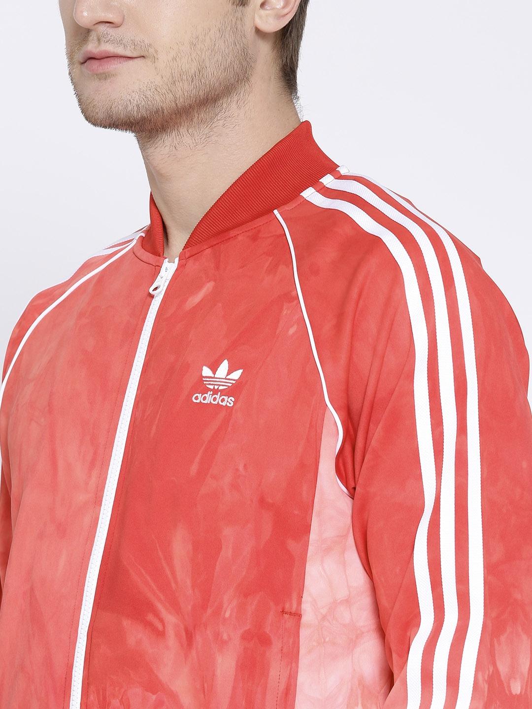 d0f9957f9a788 Buy ADIDAS Originals Men Red HU Holi SSTR TT Dyed Sporty Jacket ...