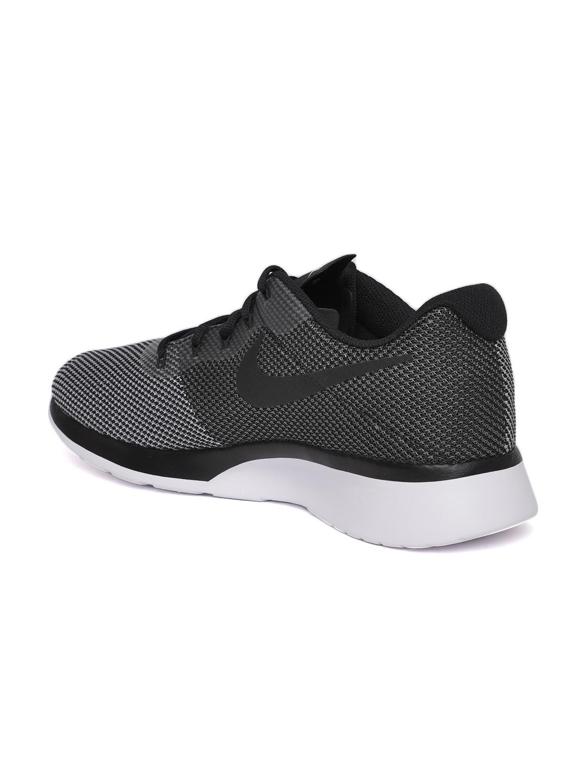 5dc2b579ecba Buy Nike Men Black   White Tanjun Racer Sneakers - Casual Shoes for ...