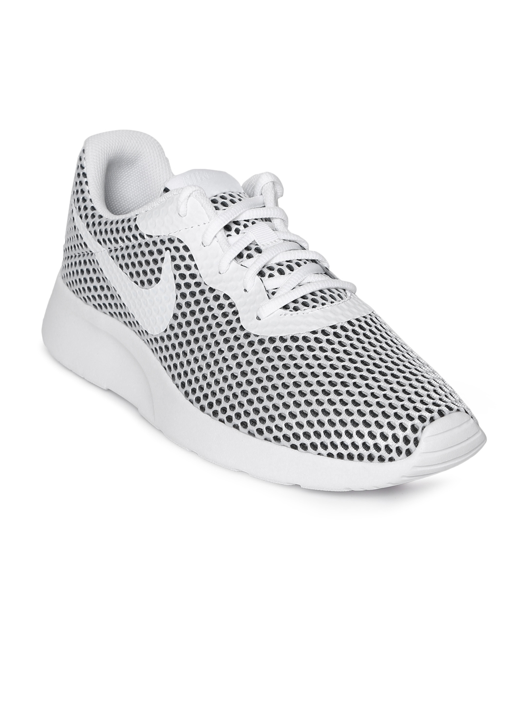 b2325ea7c7f Buy Nike Men White   Black Tanjun SE Sneakers - Casual Shoes for Men ...