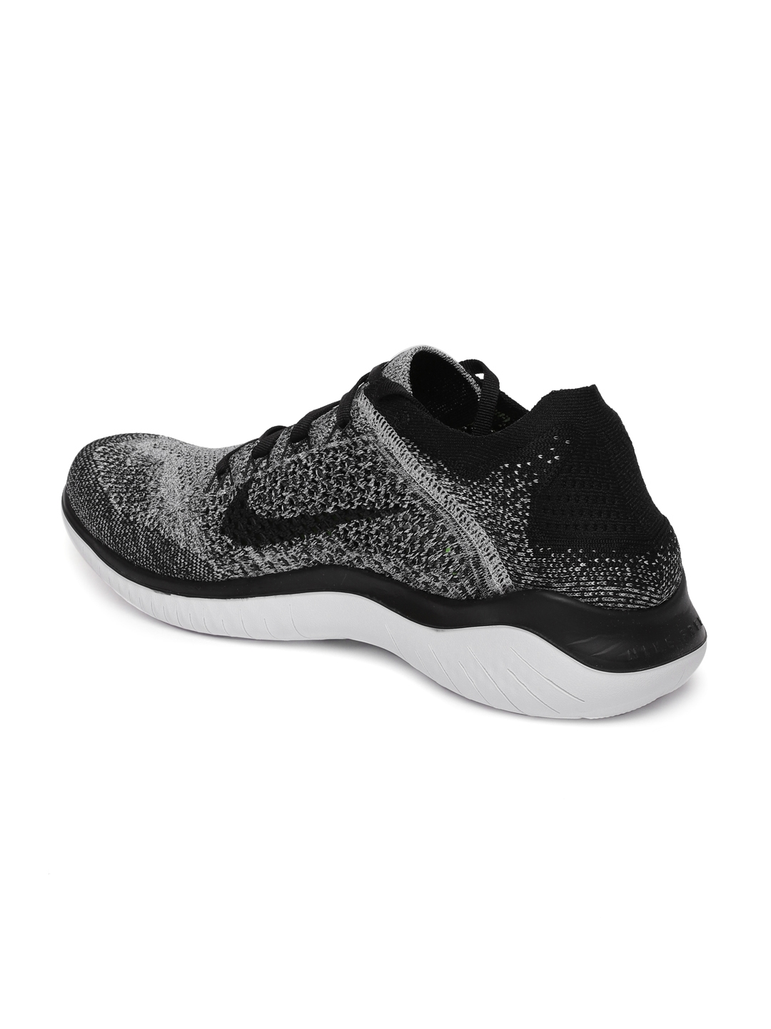 4a7cd77d2f20b Buy Nike Men White   Black Free RN Flyknit 2018 Running Shoes ...