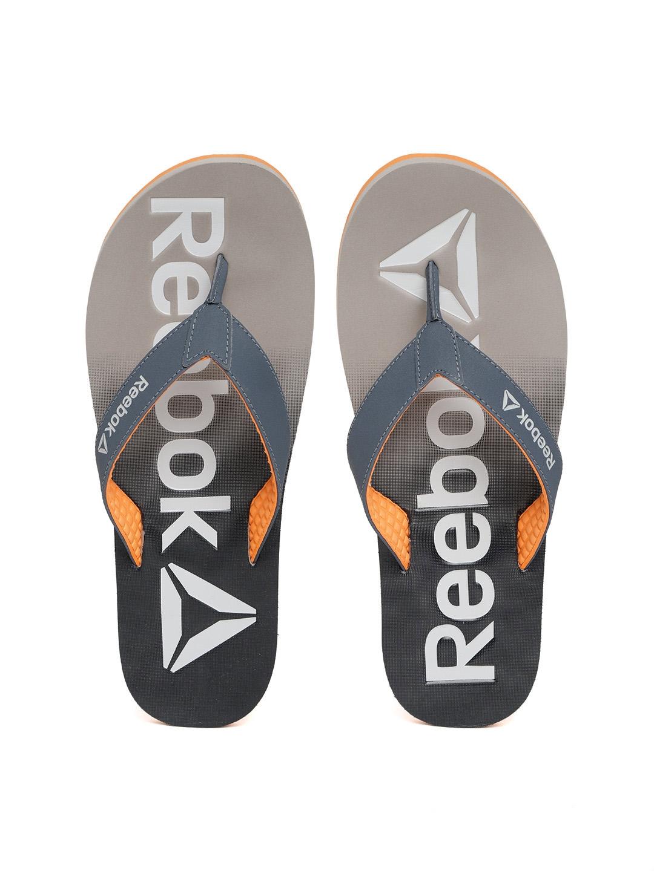 03b6e6362678de Buy Reebok Men Navy   Grey Embossed Thong Flip Flops - Flip Flops ...