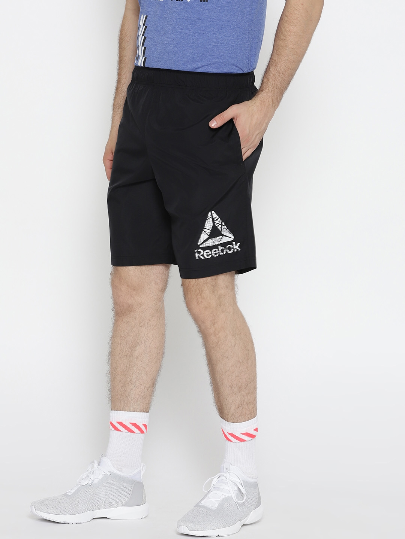 5ad033deca0 Buy Reebok Men Black WOR COMM Woven Solid Training Shorts - Shorts ...