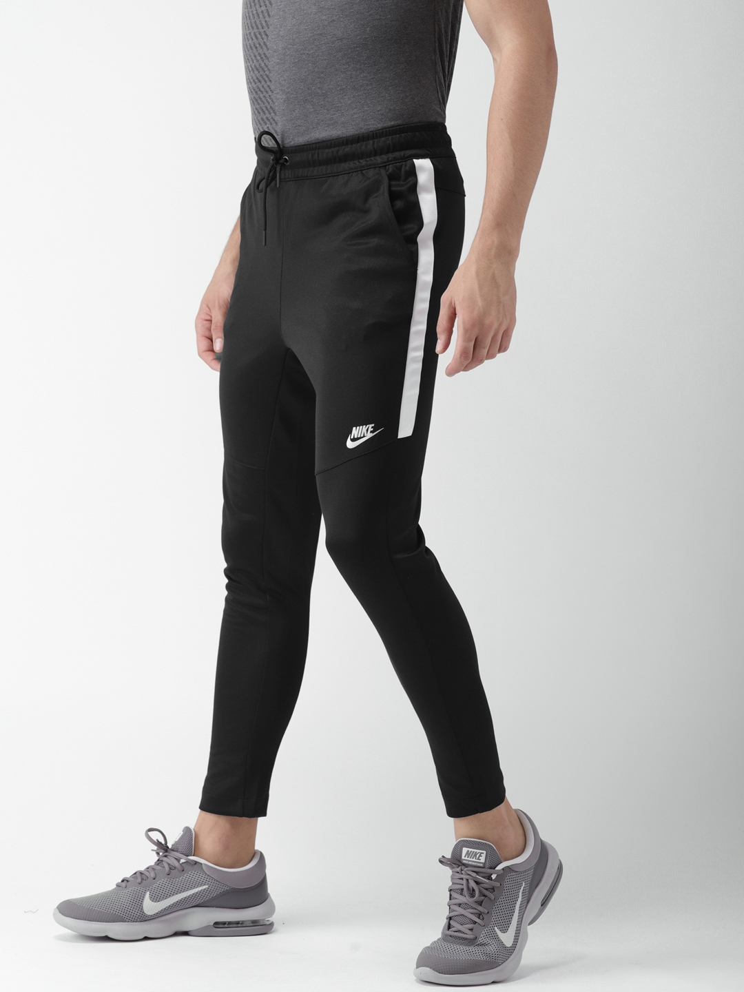 84d075a6ad Buy Nike Men Black PK TRIBUTE Solid Track Pants - Track Pants for ...